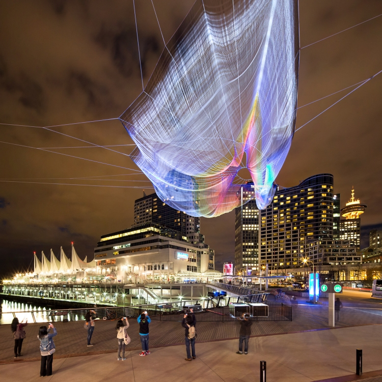 Outside the Vancouver Convention Centre, people gather to interact with Skies Painted with Unnumbered Sparks. Photo: Ema Peter